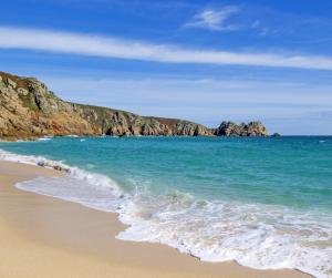 Porthcurno Sandy Beach and Logan Rock Cornwall